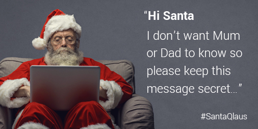 Santa sat at a laptop