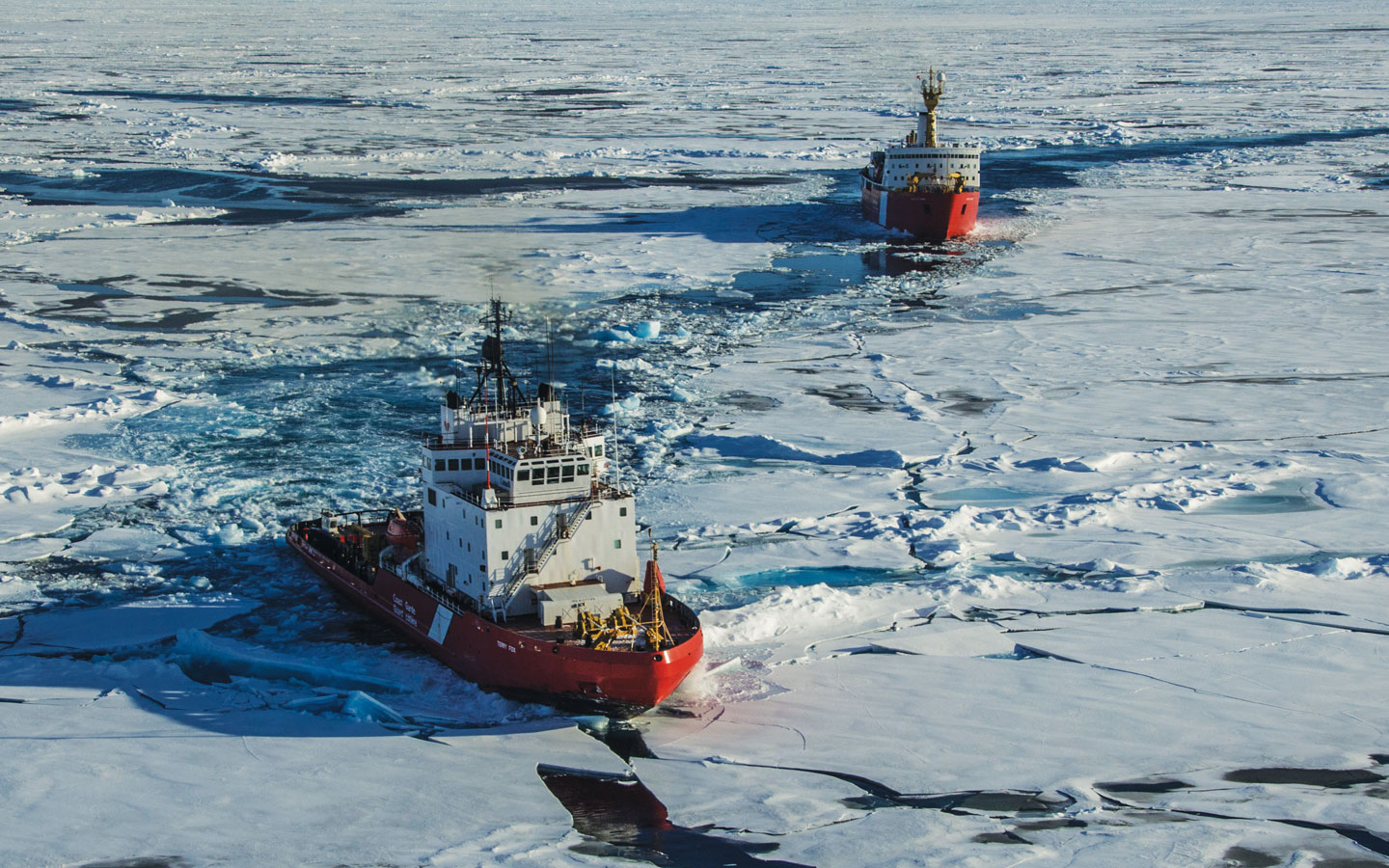 Canadian Coast guard ships breaking through the ice