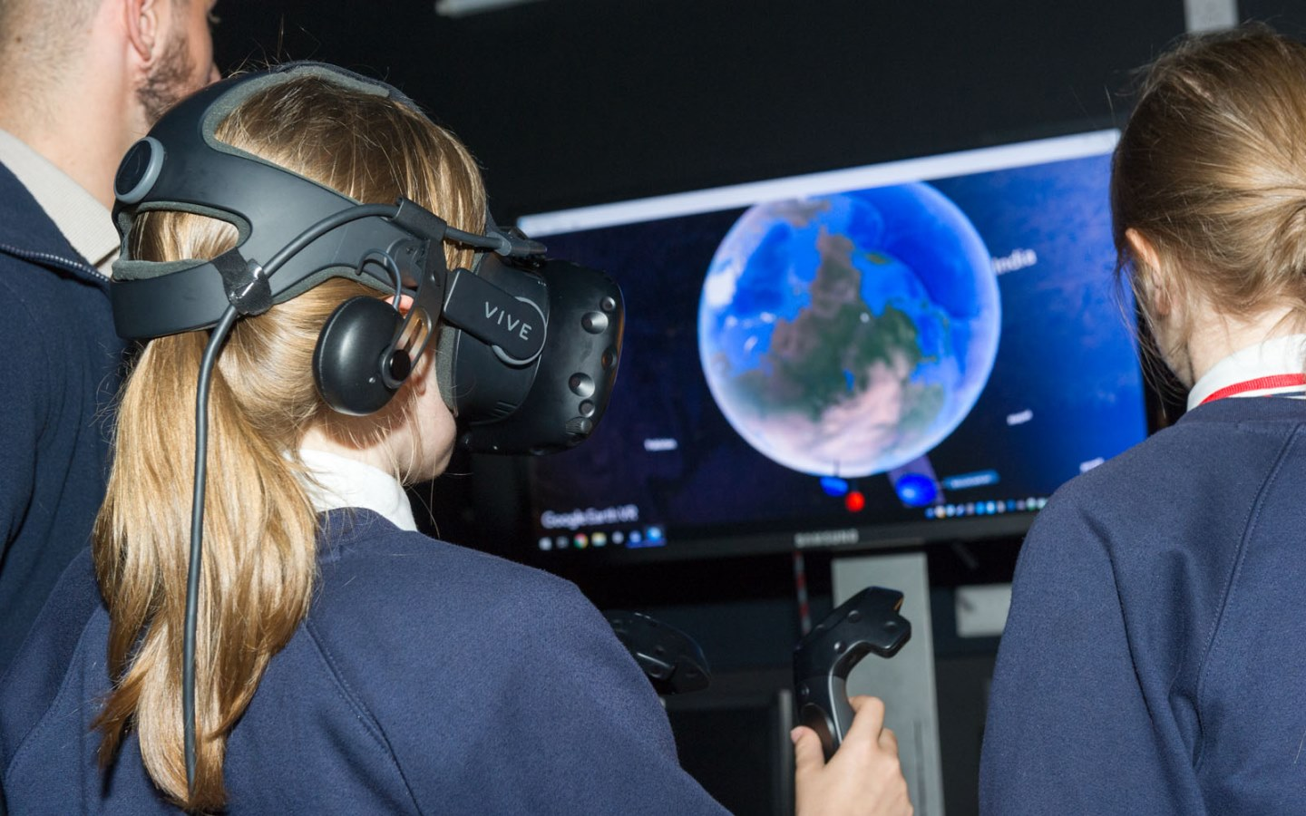 Young female engineers using VR headsets