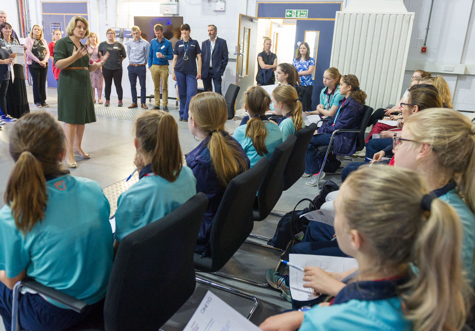 INWED students receiving a talk