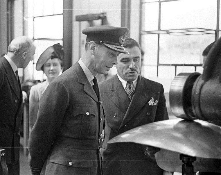 King George VI being shown how a H2S radar scanner dish is formed from sheet aluminium