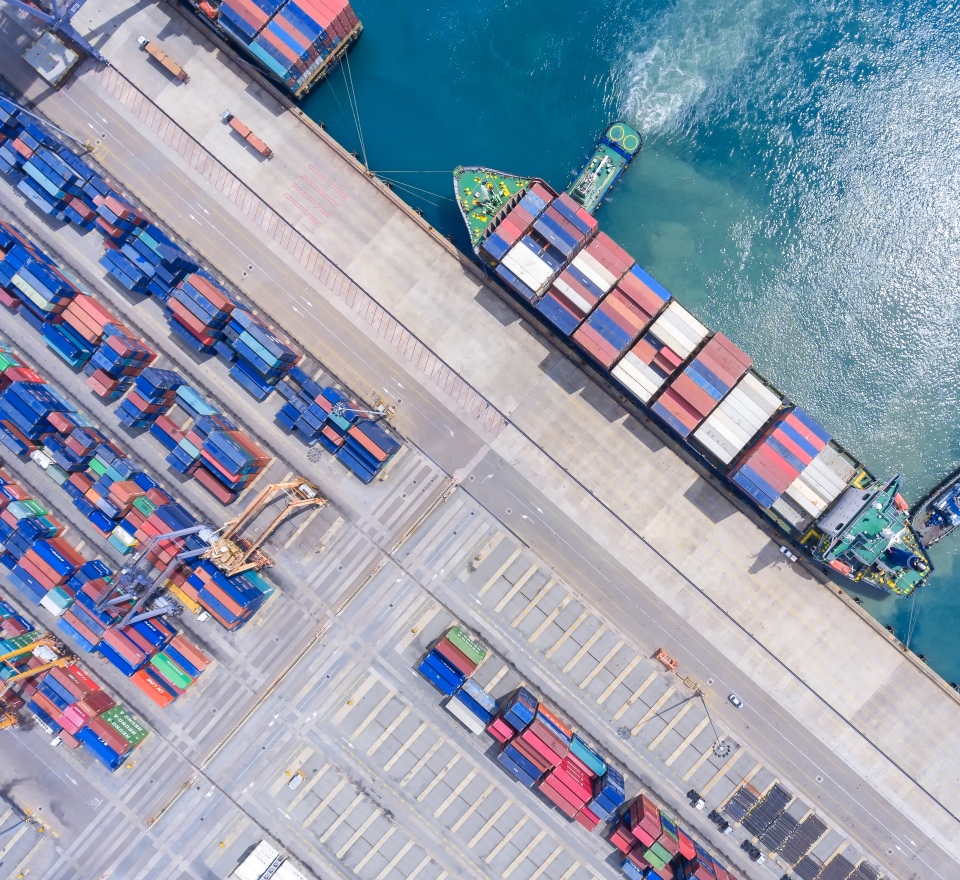 Birds eye view of a shipping container and a dock of containers