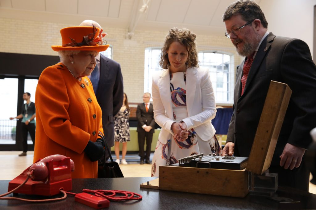 HM Queen Elizabeth with enigma machine