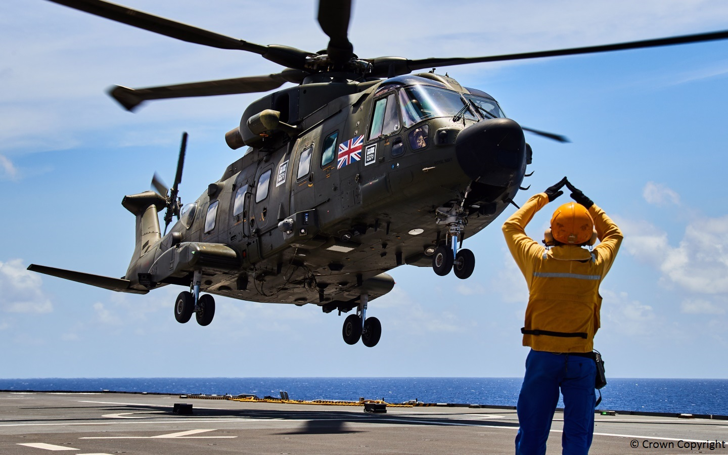 Merlin helicopter landing on an aircraft carrier
