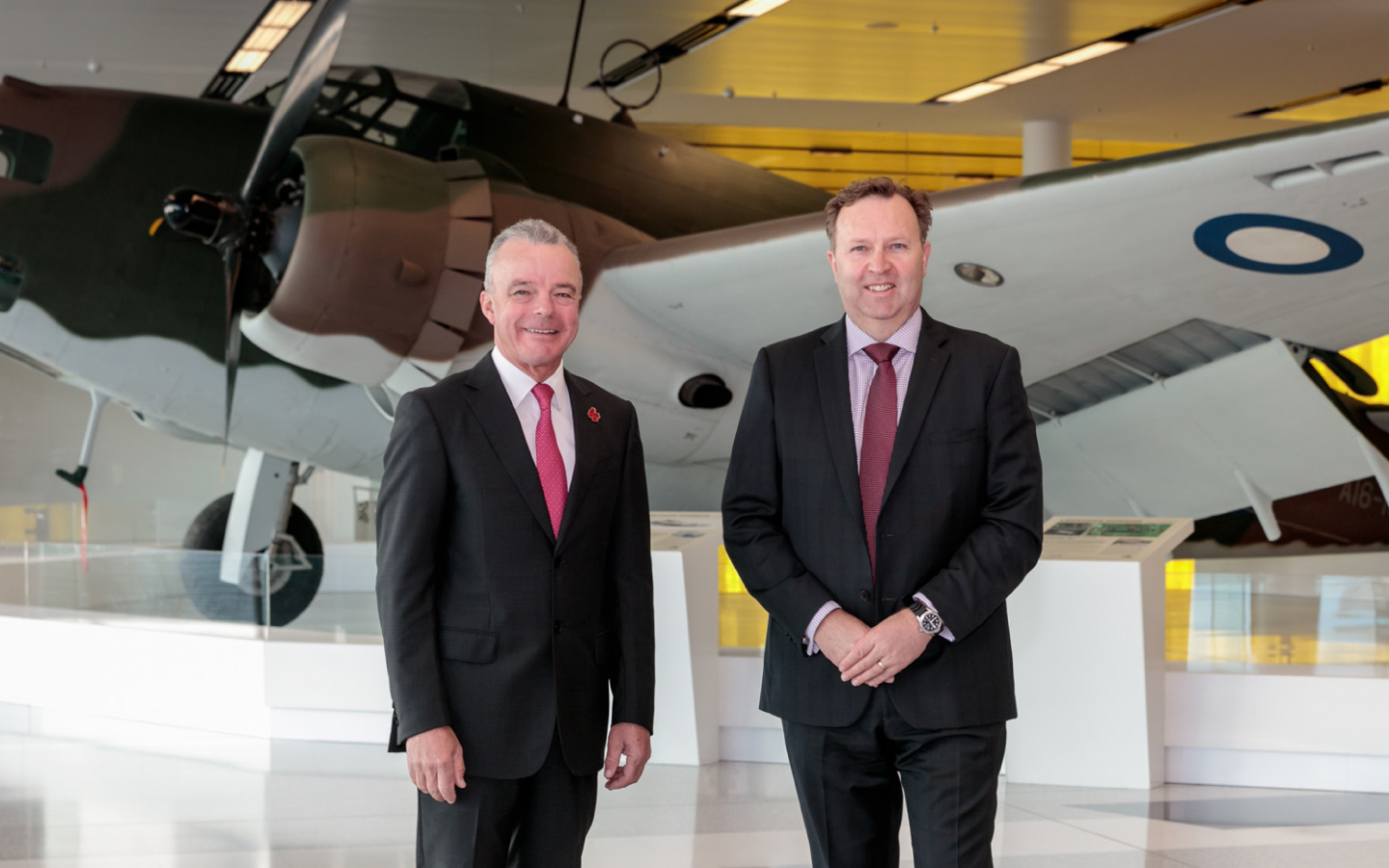 Dr Brendan Nelson and Greg Barsby in front of the Hudson Bomber at Canberra Airport