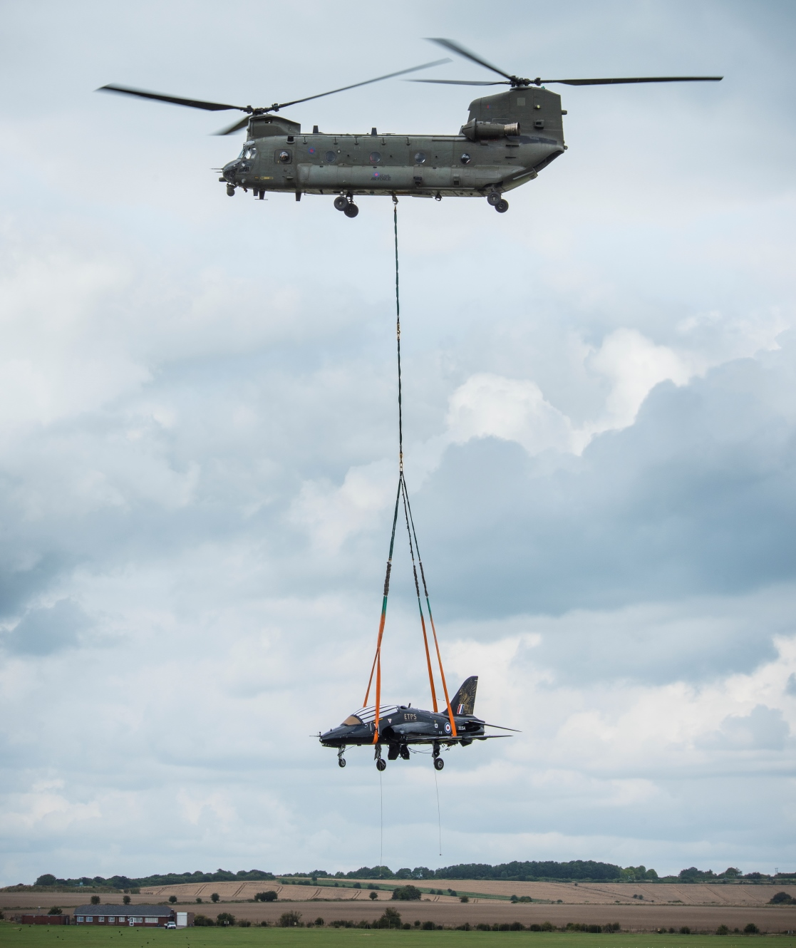 Hawk XX154 being carried by a Chinook